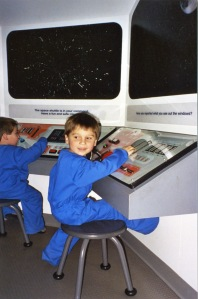 Joe and Luke playing astronaut at the museum six years ago