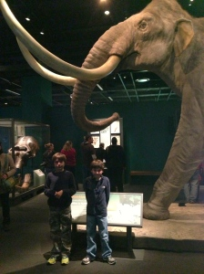 The boys are bigger but they look small next to that mammoth.