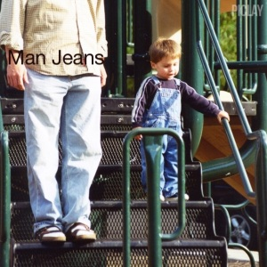 An unidentified man and a cute toddler wearing man jeans. The toddler is pulling it off.