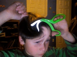 The day my 8 year old decided to cut his own hair and photograph it.